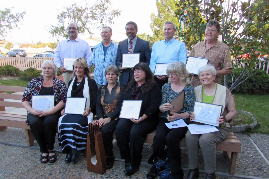 Some of the nominees for the 2014 Peace Prize pose with honoree Lauren Pressman, third from left in the front row, and the Rev. Doug Conley, the 2013 honoree and second from left in back.