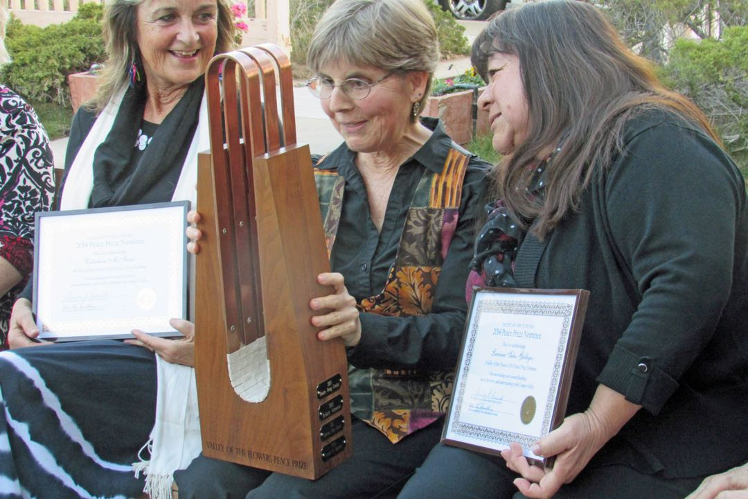 Lauren Pressman, 2014 Valley of the Flowers Peace Prize winner, with nominees Catalina McIsaac, left, and Luciana Salas Gallegos.