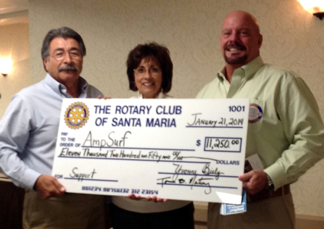 <p>Rotary Foundation chairman Tom Martinez, left, and Santa Maria Noontime Rotary President Yvonne Biely present a check for $11,250 to Ampsurf director of operations Randy Miller.</p>