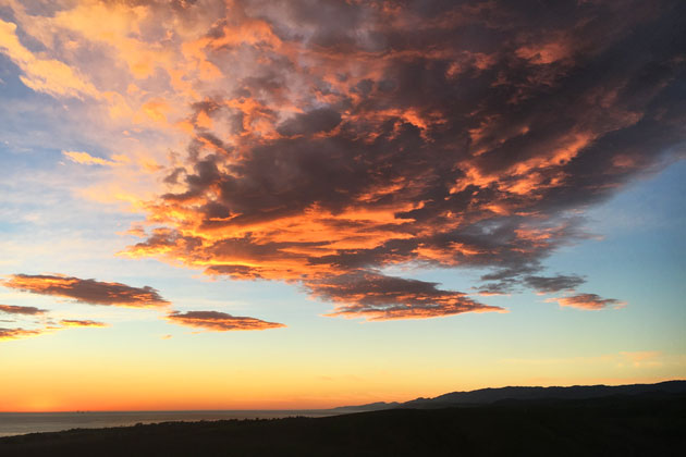 Colorful clouds Thursday night along the Gaviota Coast are a precursor of a storm expected to soak Santa Barbara County this weekend.
