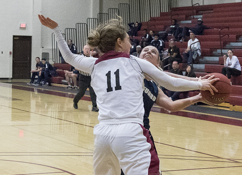 Cassidy Tiegs of Westmont denies Vanguard's Alyssa Durr from getting off a shot. The Warriors held No. 2 Vanguard to 38 points.