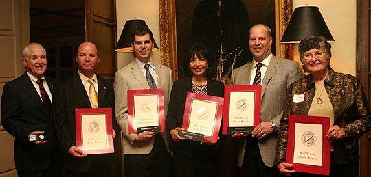 The 2009 Santa Barbara Technology & Industry Association honorees are, from left, Tom Burgher and Mike Prout of Raytheon; Paul Avolio of Latitude 34˚ Technologies; Santa Barbara police Chief Cam Sanchez, represented by his wife, Olivia; Don Kinderdick of BEGA Lighting; and former Goleta Mayor Jean Blois.
