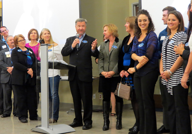 Shelby Sim, center, the Goleta Valley Chamber of Commerce's director of business development, speaks in honor of the chamber's 2012 ambassadors during Wednesday night's annual membership meeting held at Citrix Online. (Gina Potthoff / Noozhawk photo)