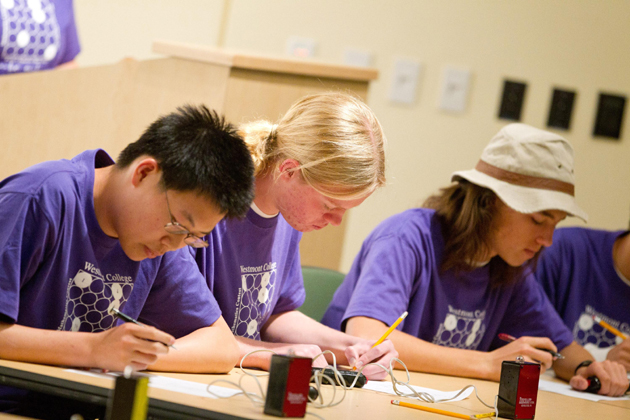 <p>Dos Pueblos High School students Brian Su, left, Alex Meiburg and Andrew Dutcher compete in a past High School Mathematics Contest at Westmont College.</p>