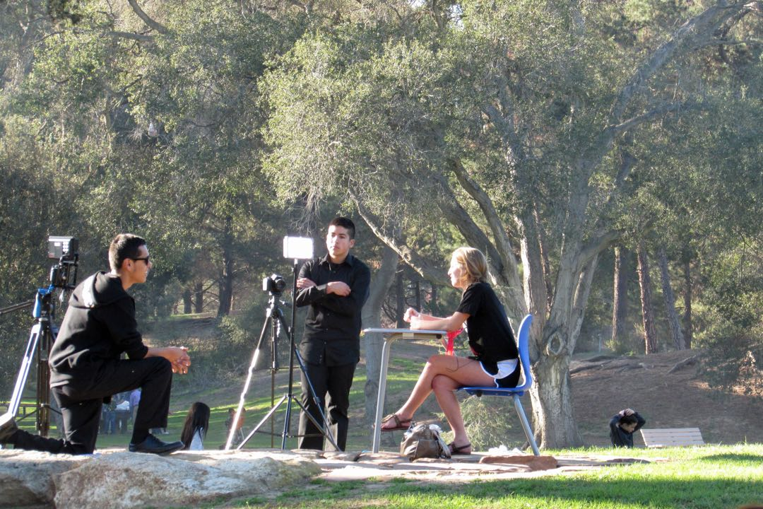 Nikolas Koyama, left, is assisted by Josh Montero while interviewing friends of Breanna Rodriguez, a Righetti High School senior killed in a crash Friday night. Koyama set up the session at Waller Park to record memories of Rodriguez and finish her video project against reckless driving.