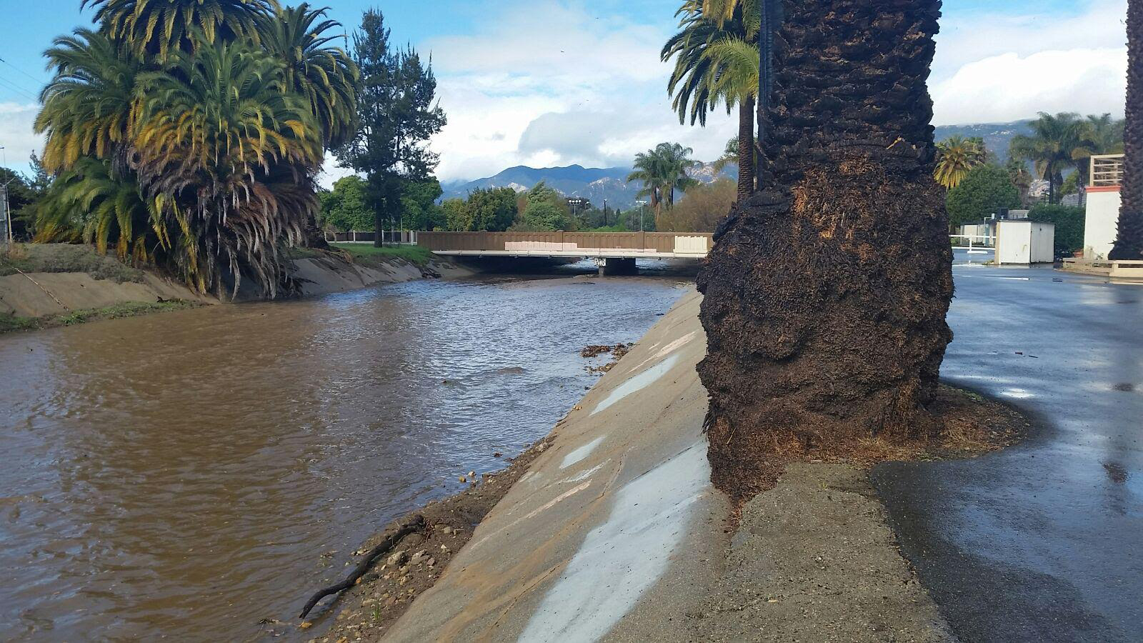 A drainage channel near Fairview and Hollister avenues in Goleta flows quickly after rainfall Sunday.
