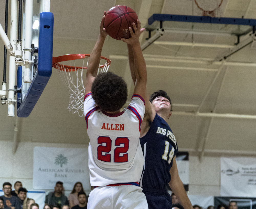 Beau Allen of San Marcos goes to the hoop against Joseph Zamora of Dos Pueblos. Allen scored 11 points off the bench.