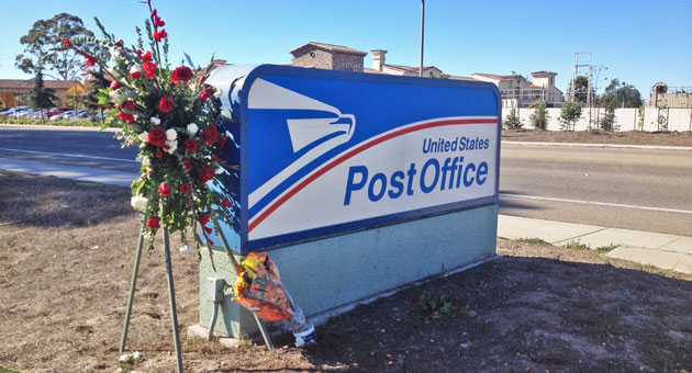 Bouquets of flowers were placed this week outide the U.S. Post Office distribution center in Goleta, where six people were gunned down in 2006. (Tom Bolton / Noozhawk photo)