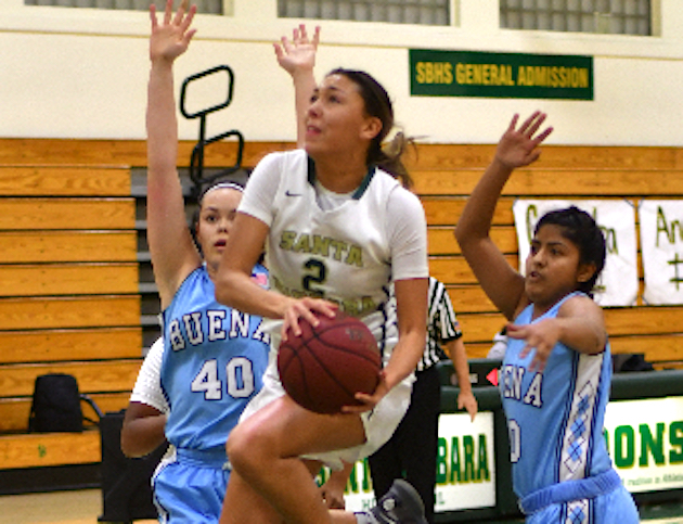 Cassandra Gordon drives past two Buena defenders for two of her game-high 23 points for Santa Barbara High.