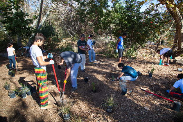 <p>Students from Peru&#8217;s Markham College plant native species alongside Cate students as part of a watershed enhancement project organized by the City of Santa Barbara&#8217;s Creeks Division. The activity was one of many they participated in during the 10-day Peaks to Piers program.</p>