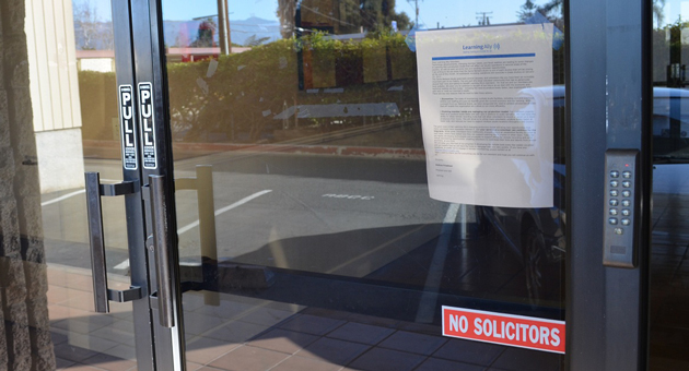 A letter from Andrew Friedman, president/CEO of Learning Ally, formerly called Recording for the Blind & Dyslexic, is posted on the door of the organization's now-closed recording studio at at 5638 Hollister Ave. in Goleta. (Giana Magnoli / Noozhawk photo)