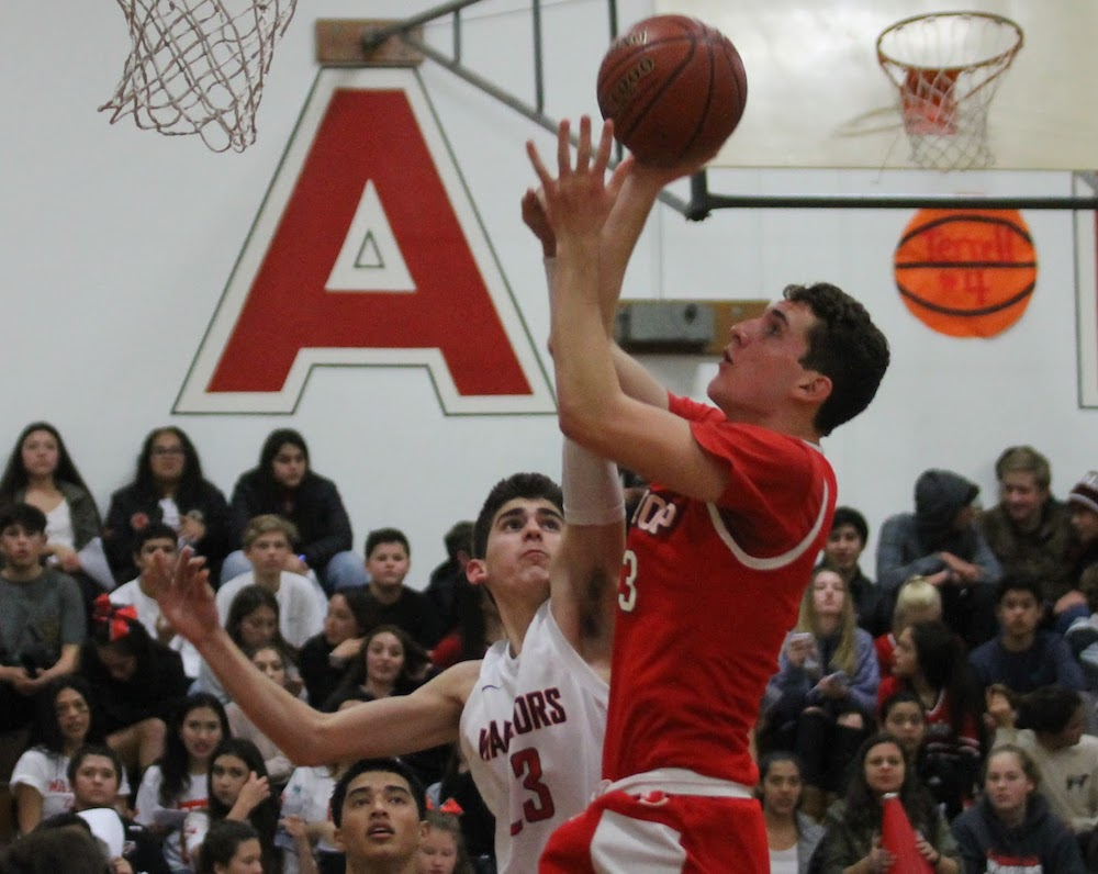 Dominic Sturdivan of Carpinteria tries to stop Bishop Diego's Mike Agnoli from scoring.