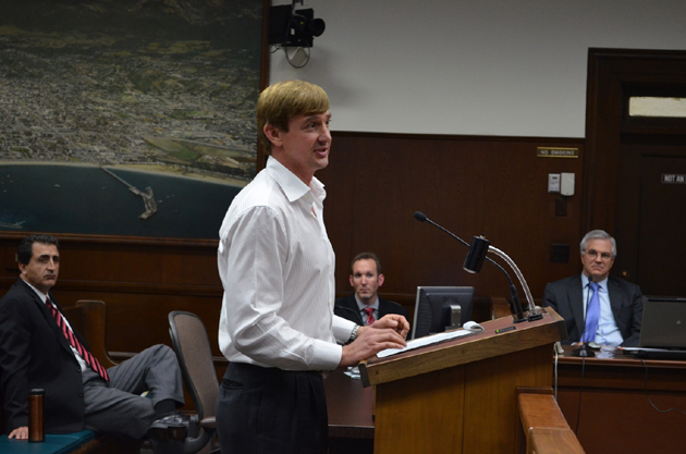 MarBorg Industries business manager Derek Carlson addresses the Santa Barbara City Council on Tuesday after environmental services director Matt Fore, center, presented the city's 10-year franchise agreement with the company for trash-hauling services. (Giana Magnoli / Noozhawk photo)