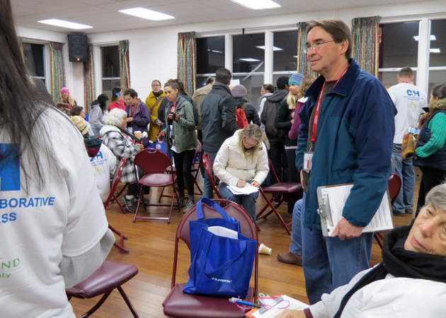Kevin Welsh gathers with dozens of volunteers in the early morning of Jan. 22 to help count and register the homeless in Santa Barbara. (Gina Potthoff / Noozhawk file photo)