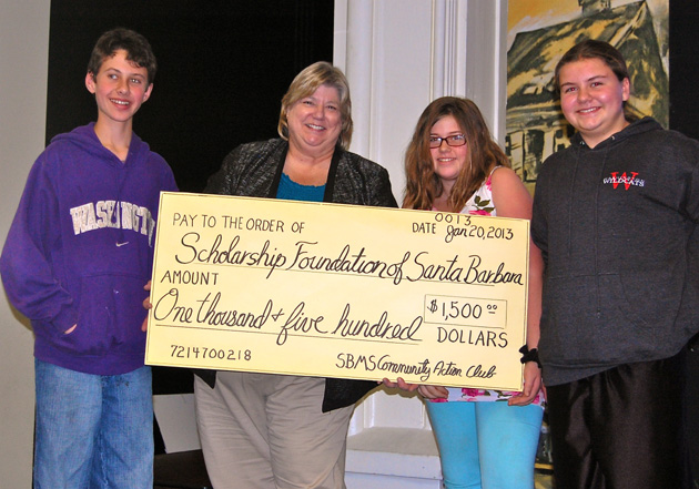 <p>Colette Hadley, executive director of the Scholarship Foundation of Santa Barbara, accepts a $1,500 scholarship donation from Santa Barbara Middle School&#8217;s student Community Action Club intended to help a young adult who has faced adverse conditions — perhaps even homelessness — at one time in his or her young life.</p>