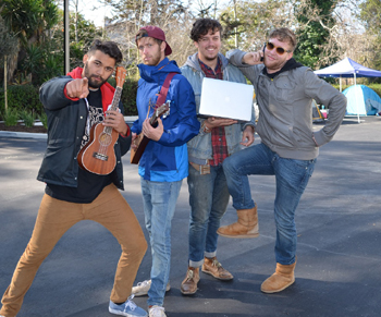 Band mates and friends Ethan Davis, left, Justin Huntsman, Mac Montgomery and Ryan Ellis camp out at the State Street Chick-fil-A on Wednesday for the free chicken and to support their friend, who will manage the Santa Barbara restaurant. (Giana Magnoli / Noozhawk photo)