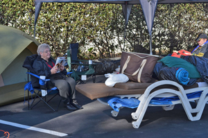 Barbara Klaus of Cypress and her husband camp out Wednesday for Thursday's grand opening of the Chick-fil-A restaurant at 3707 State St. in Santa Barbara. The couple have camped out at more than 15 Chick-fil-A store openings over the years. (Giana Magnoli / Noozhawk photo)