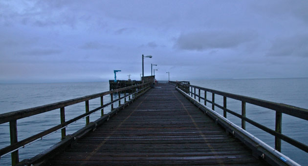 <p>The pier at Goleta Beach was nearly deserted Thursday evening, at the end of a day that saw light rain throughout the region. Forecasters were calling for a return to sunny skies on Friday.</p>