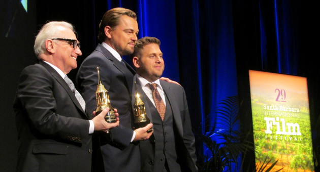 <p>Director Martin Scorsese, left, and actor Leonardo DiCaprio accept the Santa Barbara International Film Festival&#8217;s Cinema Vanguard Award from presenter and actor Jonah Hill.</p>