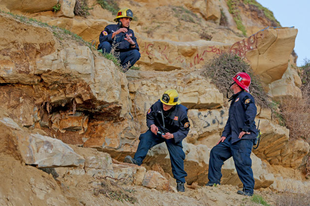 Santa Barbara County firefighters search for possible victims after a cave collapse was discovered Saturday afternoon at More Mesa Beach. No victims were found.