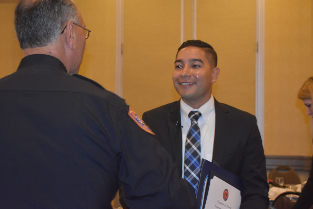 Santa maria police honor top officer swat team and others local detective jesus caro santa maria police department officer of the year accepts congratulations from spiritdancerdesigns Gallery