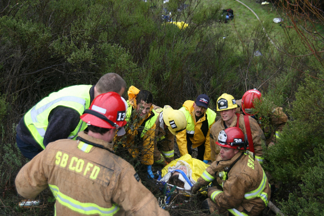 <p>Rescuers pull a crash victim out of a ravine after a vehicle went over the side of Highway 101 near the Nojoqui Grade.</p>
