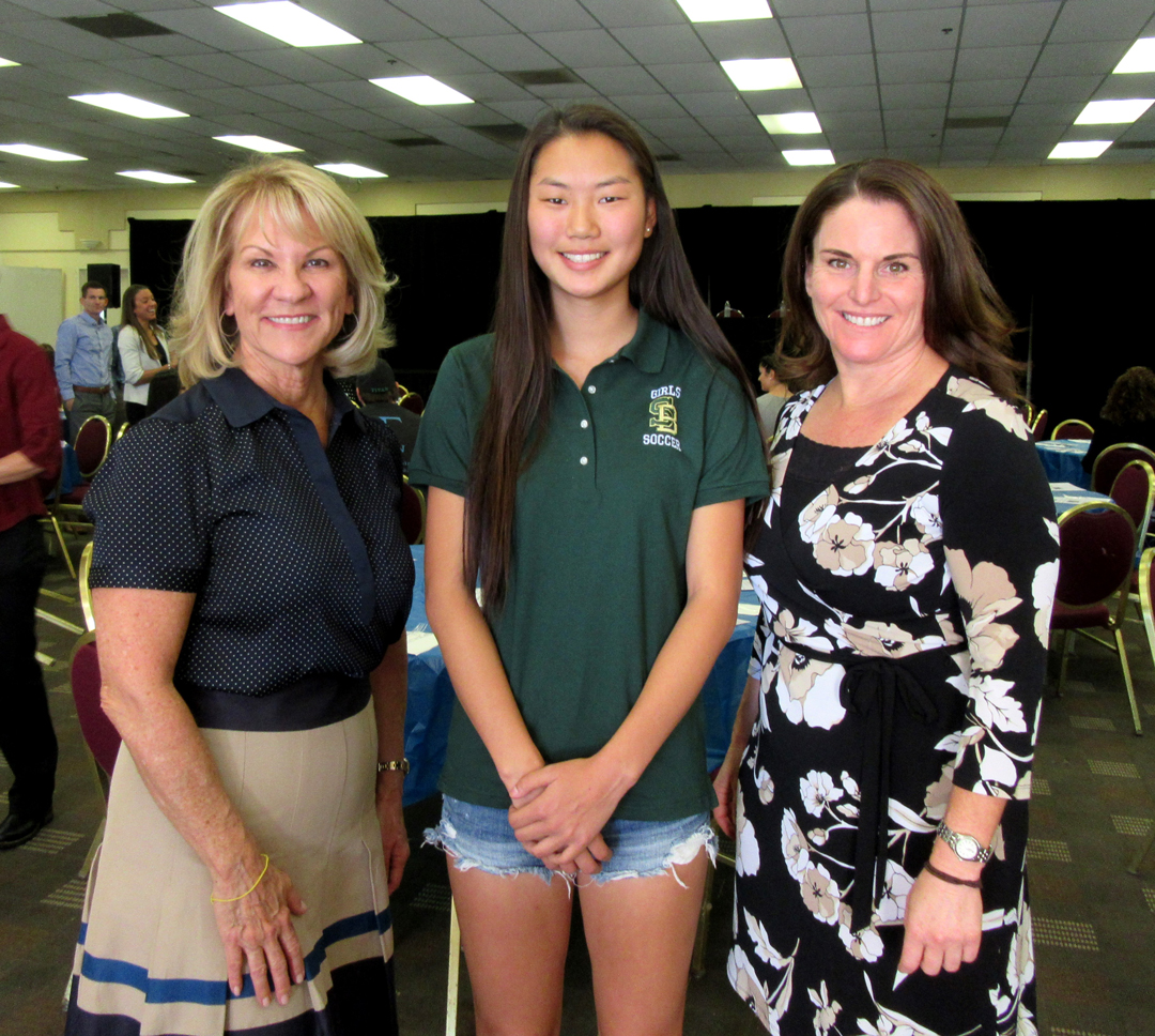 From left, sponsor Reneé Grubb of Village Properties, Santa Barbara Athletic Round Table Athlete of the Week Isabelle Mendro, and SBART board chairwoman Cara Gamberdella celebrate at Monday's luncheon.