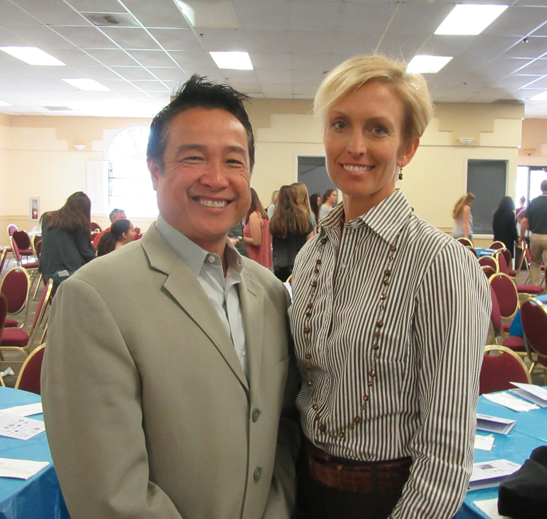 Raegan Erdman, right, and Lee Hung from sponsor WFG Title Insurance Co. attended the event.