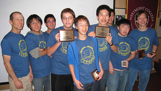 Dos Pueblos High coach Travis Bower, left, and his Grades 9-10 and 11-12 teams strike a victory pose after the 2009 Westmont College Mathematics Contest. The Chargers squad cleaned up in the competition, sweeping the Team Exam and taking first place in Chalk Talk and the College Bowl Grades 9-10.