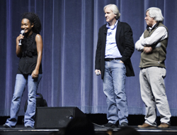 Local scientist Dijanna Figueroa, left, director James Cameron and filmmaker Mike deGruy talk with the students after Monday's screening