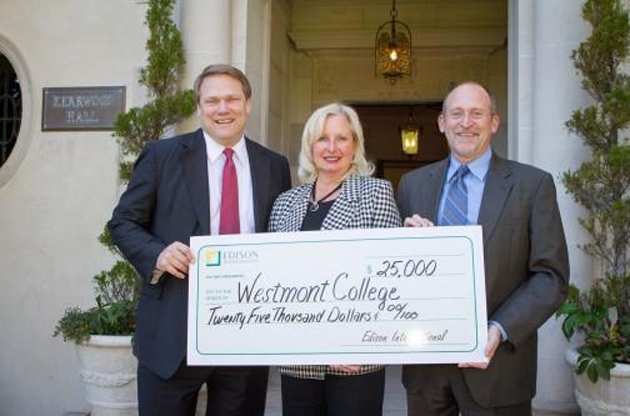 <p>Patricia Bartoli-Wible, public affairs region manager for Southern California Edison, presents a check for $25,000 to go toward STEM scholarships to Westmont College President Gayle Beebe, left, and Reed Sheard, vice president for college advancement and chief information officer.</p>