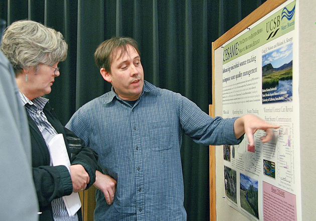 <p>Patricia Holden, left, director of UCSB's Natural Reserve System, checks out a research project during the poster session at the inaugural Natural Reserve System Day.</p>