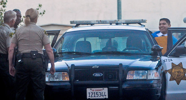 Murder defendant Miguel Parra gets into a patrol car after leaving court Wednesday  in Santa Barbara. Parra is among three men charged with murder in the October 2010 slaying of George Ied. (Lara Cooper / Noozhawk photo)