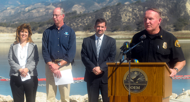 <p>Joined by other officials on the shore of Lake Cachuma, Santa Barbara County Fire Chief Mike Dyer speaks at a news conference Friday to urge the public to conserve water. The lake is at less than 40 percent capacity.</p>