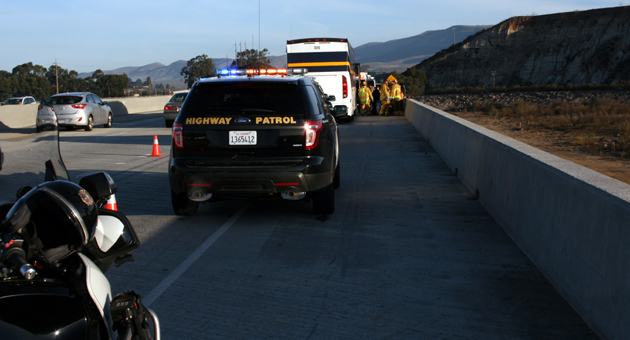 <p>Emergency crews respond Friday after two female passengers brought their Amtrak bus to a safe stop on the Santa Maria River Bridge after the driver fell unconscious and lost control.</p>