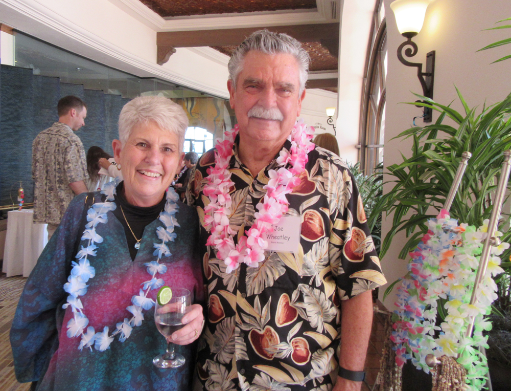 Board member Joe Wheatley, with wife Pat, passed out colorful leis.