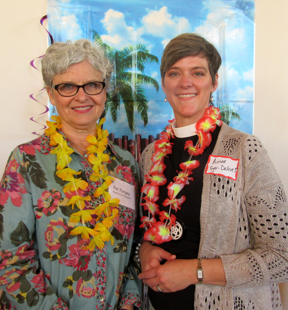 Board vice president Pat Forgey, left, with the Rev. Aimee Eyer-Deleve of All Saints-by-the-Sea Episcopal Church.