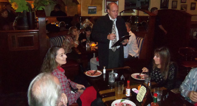 Detective Diddle questions the guests, er, diners at 'Murder on the Waterfront.' (David Couch photo)