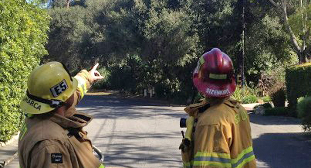 Santa Barbara firefighters keep a watchful eye on downed power lines that sparked several small blazes in the San Roque area Saturday afternoon. (Santa Barbara City Fire Department photo)