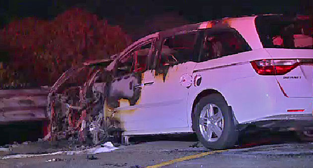 It's hard to believe that the four occupants of this burned-out Honda Odyssey made it out alive, but they did. In front of the van is all the remains of an Infinit sedan, whose driver caused the fiery wrong-way crash and died in the wreckage. (Paul Mihalec / KEYT News photo)