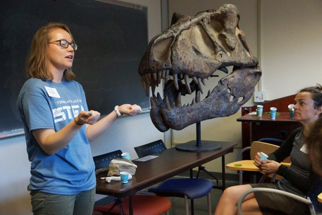 "Laura Reynolds, a UCSB graduate student in the Department of Earth Science, leads parents through the ""Fossils Rock"" workshop at the 2015 Tech Savvy conference."