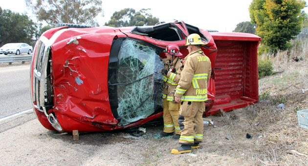 <p>Emergency crews respond Tuesday to a single-vehicle rollover crash on Highway 101 near Fairview Avenue and Los Carneros Road.</p>