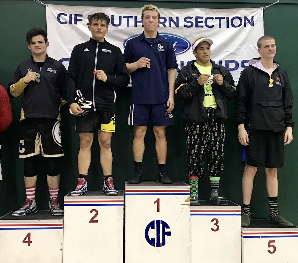 Will Yamasaki of Dos Pueblos stands at the top of the podium after winning the 184-pound title at the CIF-SS Individiual Wrestling Championships