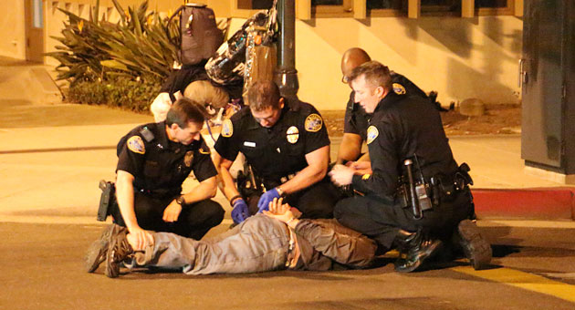 <p>Santa Barbara police subdue Kenneth Ruz, 49, who is was arrested for allegedly cutting down an Amercan flag in De La Guerra Plaza Wednesday night.</p>