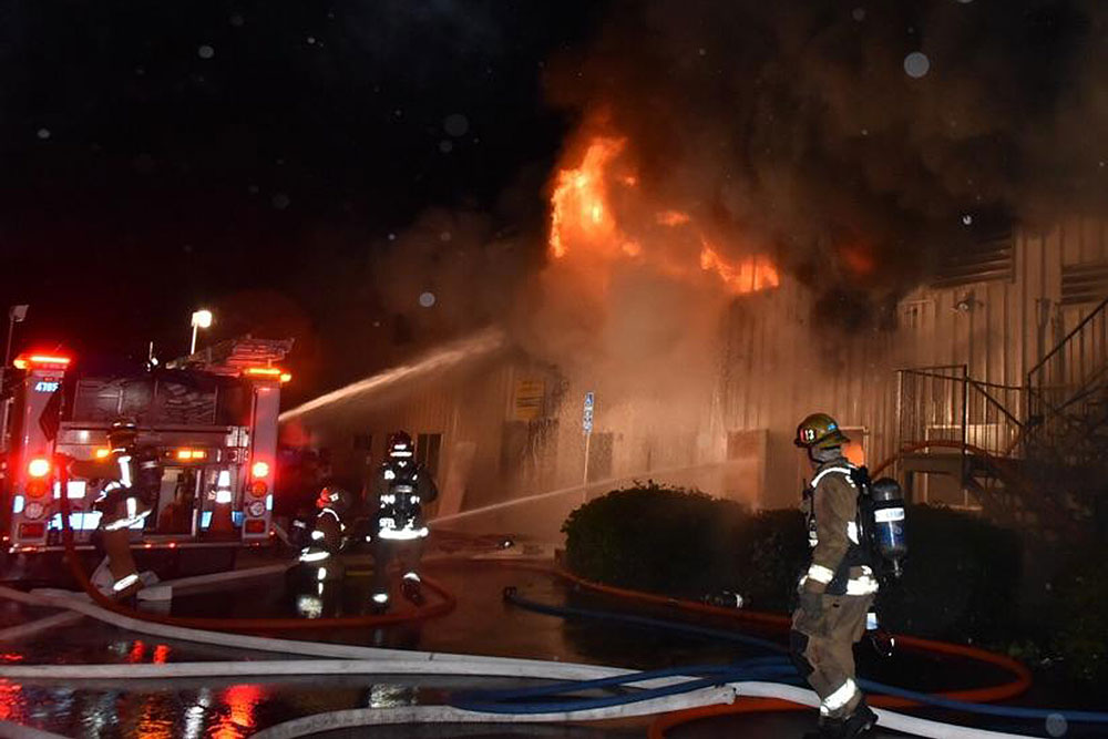 Firefighters Battle A Three Alarm Structure Fire At A Building Occupied By Derricks Roofing And