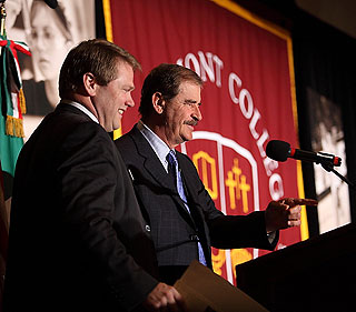 Westmont President Gayle Beebe and former Mexican President Vicente Fox share a photo opportunity at the podium.