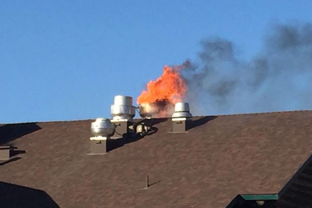 Flames are visible on the roof of the AJ Spurs restaurant in Buellton on Tuesday. A fire that began in the kitchen area caused significant damage to the popular eatery.