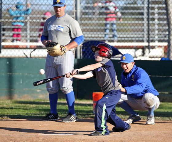 A Little League Challengers player connects with a baseball during a Skills Clinic with UCSB players on Feb. 8 at Girsh Park. (Little League Challengers photo)