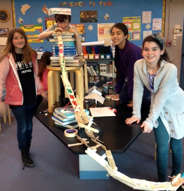 <p>Crane Country Day School students show off their roller coaster.</p>