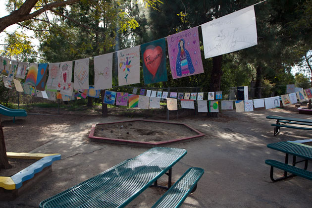 Student-created prayer flags, decorated with their letters to teacher Carmen Alexander, hang across the campus of Open Alternative School in Santa Barbara. Alumni, parents, students and teachers gathered Wednesday morning to remember Alexander, who died unexpectedly Tuesday from a mysterious flesh-eating bacteria.
